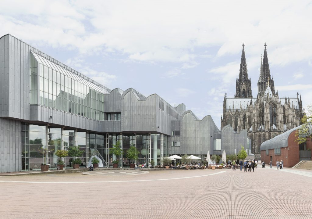 The Ludwig Museum is directly behind Cologne's famous Gothic cathedral, Germany's most popular visitor attraction.qThe Ludwig Museum is directly behind Cologne's famous Gothic cathedral, Germany's most popular visitor attraction.