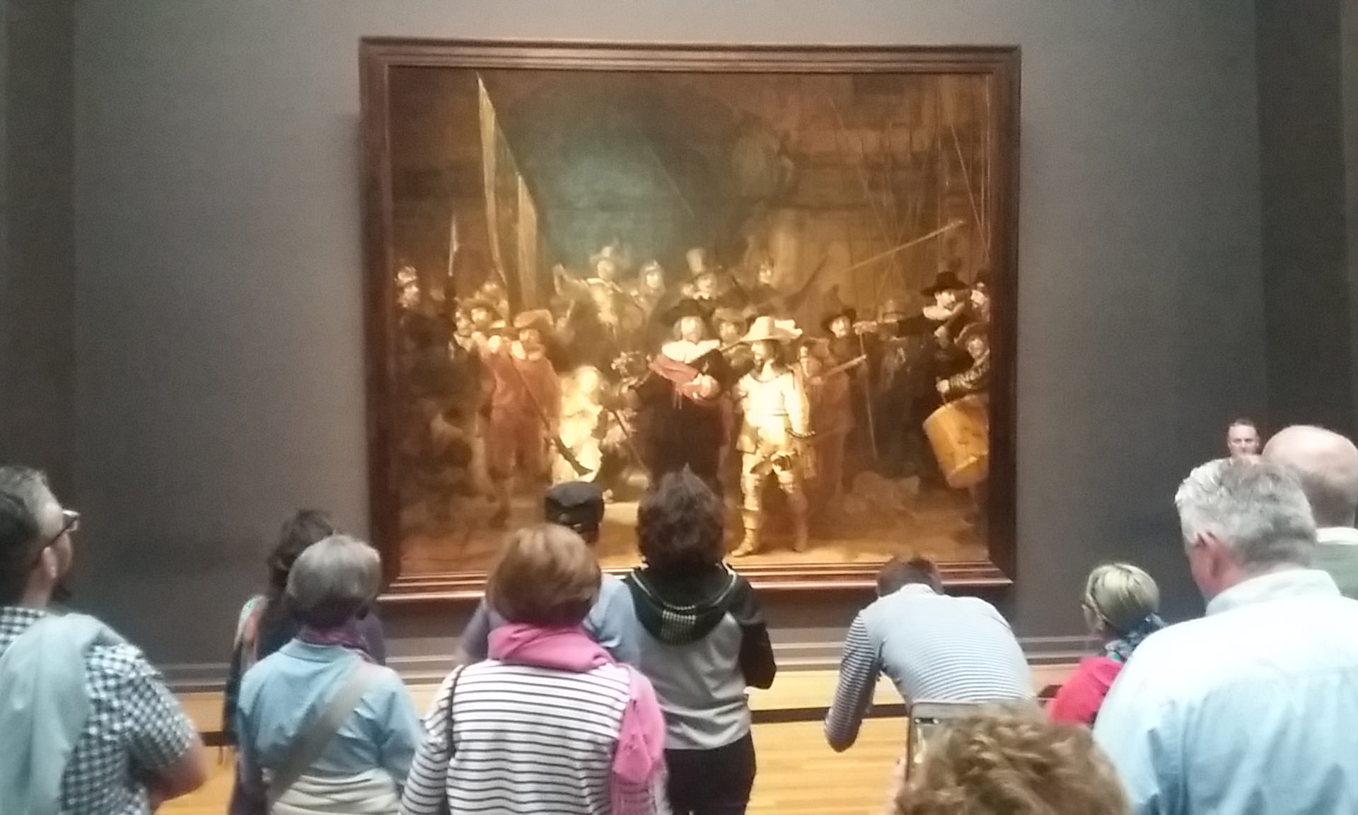 Visitors admire 'The Night Watch' in the Rijksmuseum