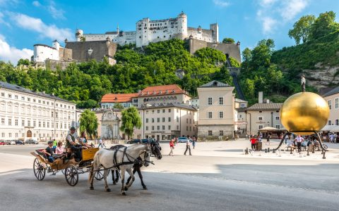 The Salzburg Fortress looms over Kapitelplatz and Stephan Balkenhol's 'Sphaera' (right)