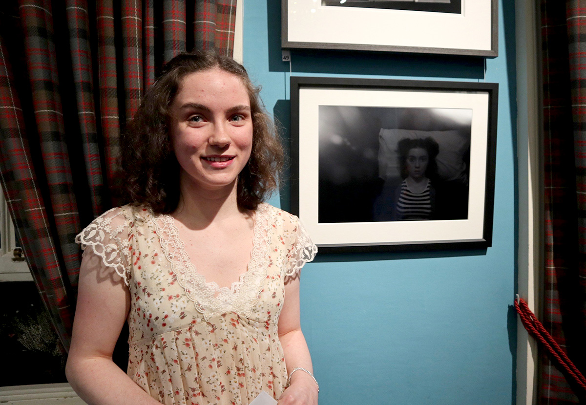 Brenna Collie with her portra it 'Trapped', winner of the £500 SPA Young Photographer Award, (Photo by George McBean)