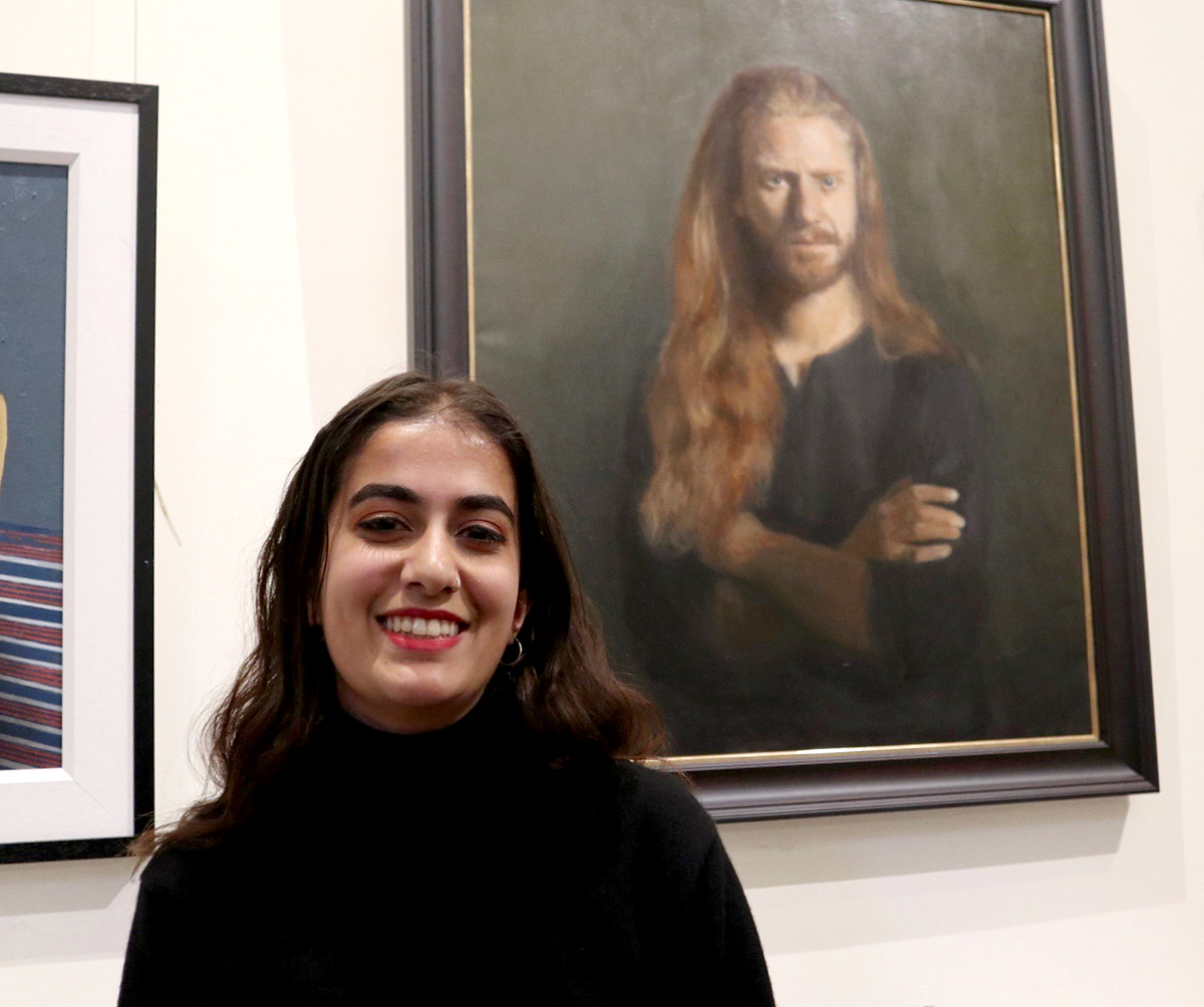 Grace Payne Kumar with her Portrait of Niccolo which won a Commendation, Young Fine Artist (photo by George McBean)