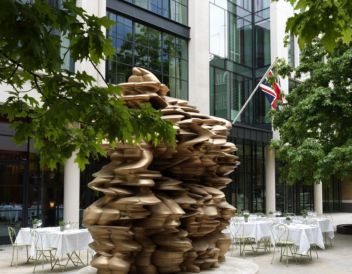 Tony Cragg's Group (2014) stands outside the Ham Yard Hotel