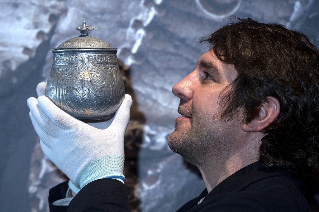 Dr Martin Goldberg, Principal Curator, Medieval Archaeology & History at National Museums Scotland examines the 3D model of the vessel. Photograph Neil Hanna.