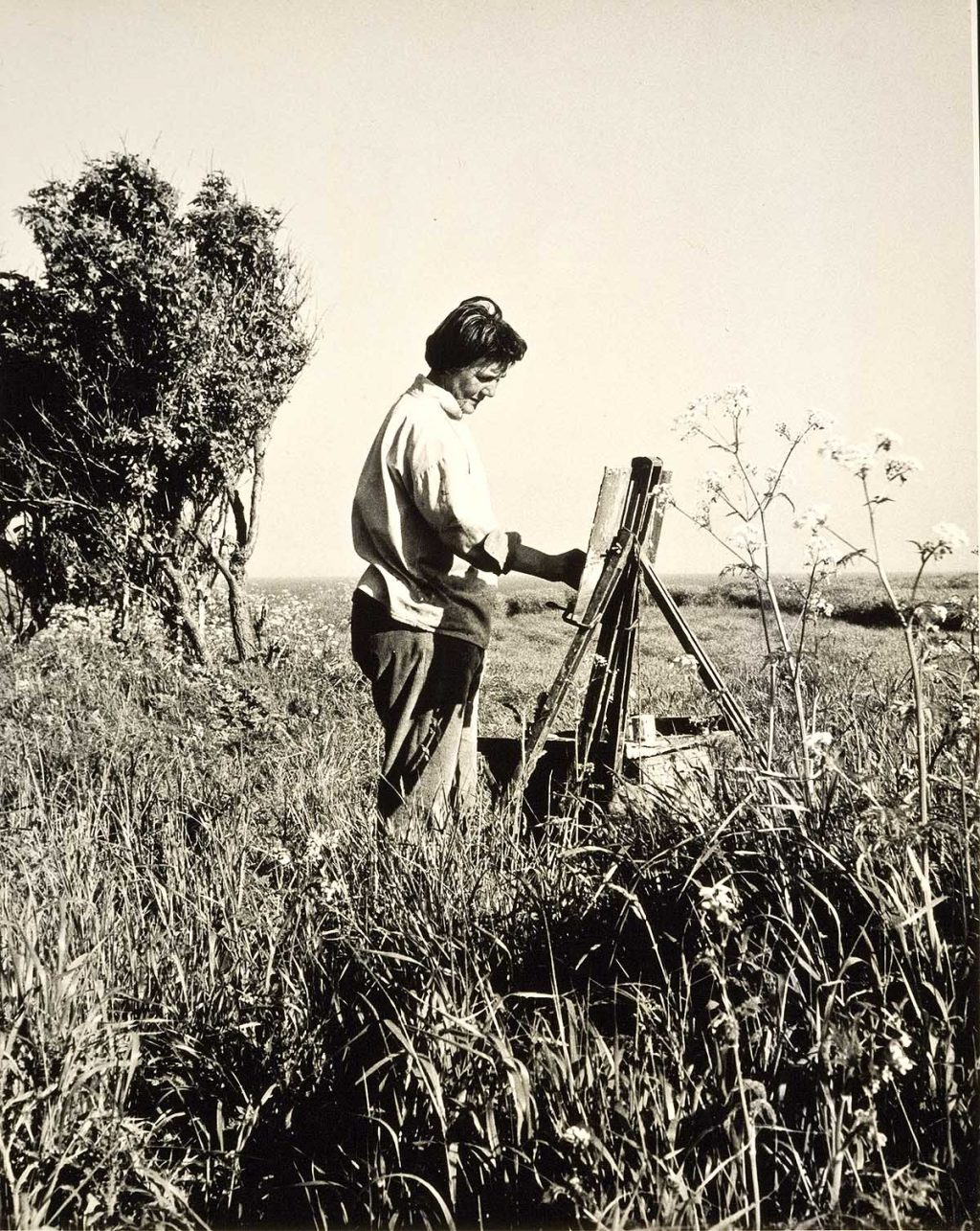 Joan Eardley painting out in the meadow at Catterline (Photograph by Audrey Walker, 1961)