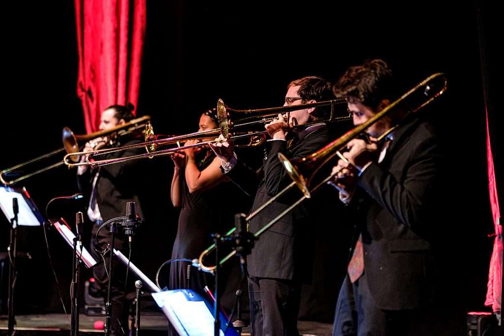 The Scottish National Jazz Orchestra trombones. Photo Derek Clark